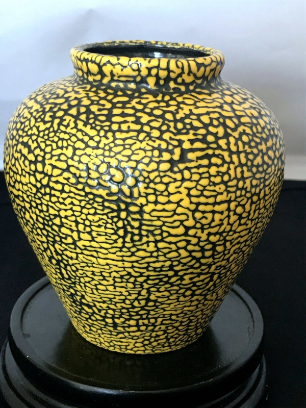 Extremely Rare Yellow Glazing Drops Over Black glaze background Pot
